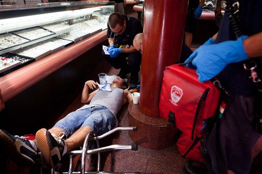 "<div class=""meta image-caption""><div class=""origin-logo origin-image ""><span></span></div><span class=""caption-text"">Paramedics begin first-aid on a man who collapsed from heat exhaustion in a jewelry store in New York Friday, July 22, 2011. Americans withered under yet another day of searing sun as a heat wave spread in earnest and temperatures hit 100 in New York's Central Park. (AP Photo/John Minchillo) (AP Photo/ John Minchillo)</span></div>"