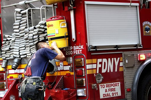 A firefighter drinks from a cooler attached to the back of the fire truck Friday, July 22, 2011 in New York. The temperature has hit 103 degrees in Central Park, with a heat index of 113&#40;AP Photo&#47;Mary Altaffer&#41; <span class=meta>(AP Photo&#47; Mary Altaffer)</span>