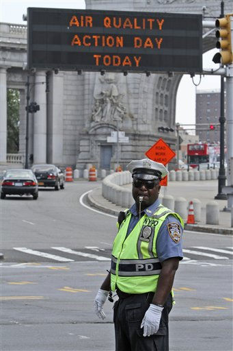 A traffice officer directs traffic on Canal St. at the entrance to the Manhattan bridge in New York on Friday, July 22, 2011. Temperatures in New York reached over 100 degrees Fahrenheit. &#40;AP Photo&#47;Mary Altaffer&#41; <span class=meta>(AP Photo&#47; Mary Altaffer)</span>