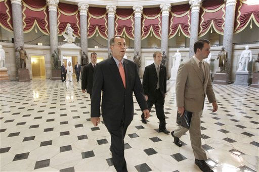 House Speaker John Boehner of Ohio, walks to the House floor to take up his postponed legislation that was rewritten overnight to win the support of conservative holdouts demanding action on a constitutional balanced-budget amendment, Friday, July 29, 2011, on Capitol Hill in Washington.  &#40;AP Photo&#47;J. Scott Applewhite&#41; <span class=meta>(AP Photo&#47; J. Scott Applewhite)</span>