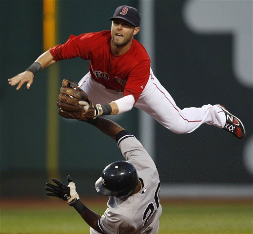 Boston Red Sox second baseman Dustin Pedroia, top, leaps over New York Yankees&#39; Eduardo Nunez as he makes the force on a single by Derek Jeter in the third inning of a baseball game at Fenway Park in Boston, Friday, Aug. 5, 2011. &#40;AP Photo&#47;Charles Krupa&#41; <span class=meta>(AP Photo&#47; Charles Krupa)</span>