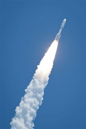 In this photo provided by NASA, an Atlas V rocket launches with the Juno spacecraft payload from Space Launch Complex 41 at Cape Canaveral Air Force Station in Florida on Friday, Aug.  5, 2011. NASA launched the spacecraft atop an unmanned rocket that blasted into a clear midday sky as scientists cheered and yelled &#34;Go Juno!&#34;  It was the first step in Juno&#39;s 1.7 billion-mile voyage to the gas giant Jupiter, just two planets away but altogether different from Earth and next-door neighbor Mars. &#40;AP Photo&#47;NASA, Bill Ingalls&#41; <span class=meta>(AP Photo&#47; Bill Ingalls)</span>