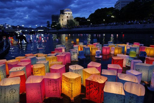 Paper lanterns float along the Motoyasu River in front of the illuminated Atomic Bomb Dome near Hiroshima Peace Memorial Park in Hiroshima, western Japan, Saturday, Aug. 6, 2011.  The Japanese city of Hiroshima on Saturday marked the 66th anniversary of the bombing, as the nation fights a different kind of disaster from atomic technology - a nuclear plant in a meltdown crisis after being hit by a tsunami.   &#40;AP Photo&#47;Koji Sasahara&#41; <span class=meta>(AP Photo&#47; Koji Sasahara)</span>