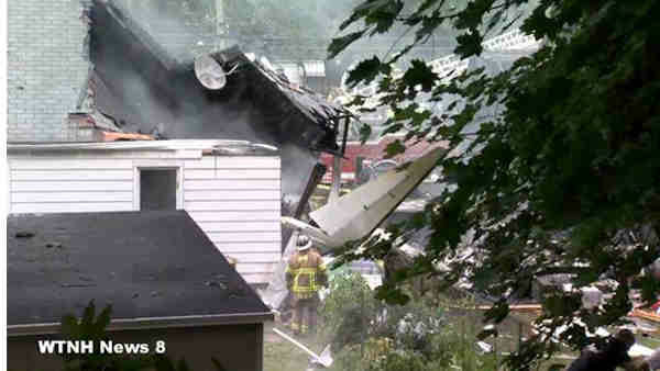 A small plane crashed into two homes in East Haven, Connecticut on Friday August 9, 2013. <span class=meta>(WTNH&#47;New Haven Register)</span>