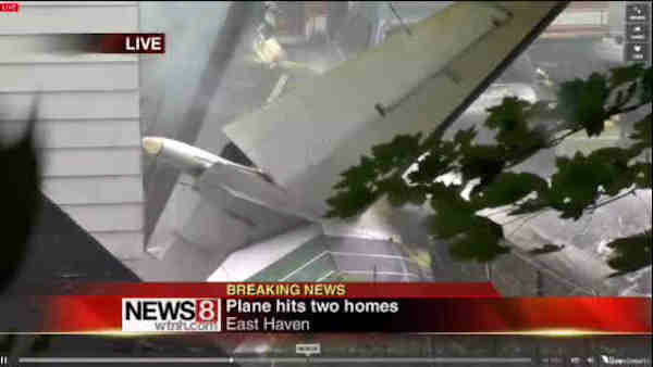 "<div class=""meta image-caption""><div class=""origin-logo origin-image ""><span></span></div><span class=""caption-text"">A small plane crashed into two homes in East Haven, Connecticut on Friday August 9, 2013. (WTNH/New Haven Register)</span></div>"