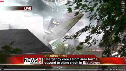 "<div class=""meta ""><span class=""caption-text "">A small plane crashed into two homes in East Haven, Connecticut on Friday August 9, 2013. (WTNH/New Haven Register)</span></div>"