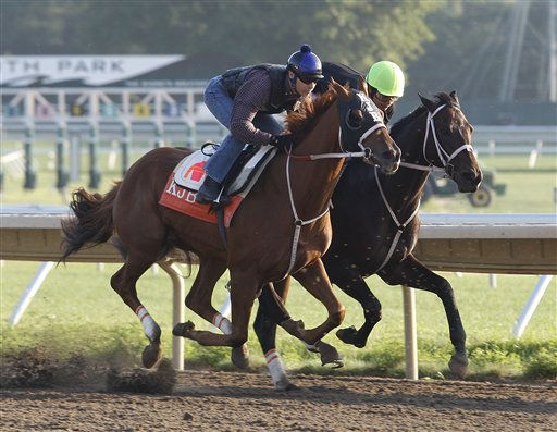 In this photo provided by Equi-Photo, trainer Kelly Breen sends out his top duo of three-year-olds, Belmont Stakes Champion Ruler On Ice, left,  with jockey Jose Valdivia, Jr. and Louisiana Derby Winner Pants On Fire  with jockey Elvis Trujillo, for a half mile workout on Saturday, Aug. 20, 2011 at their home base of Monmouth Park in Oceanport, N.J.  Ruler On Ice will make his next start in the &#36;1,000,000 Travers Stakes at Saratoga Racecourse in Saratoga, N.Y. on August 27, and Pants On Fire is expected to make his next start in the &#36;300,000 Smarty Jones Stakes on Sept. 5  at Parx Racing in Bensalem, Pa.  &#40;AP Photo&#47;EQUI-PHOTO,  Bill Denver&#41; <span class=meta>(AP Photo&#47; Bill Denver)</span>