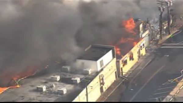 Fire crews are on the scene battling huge blaze at the Kohrs Custard shop on the boardwalk in Seaside Park, New Jersey.