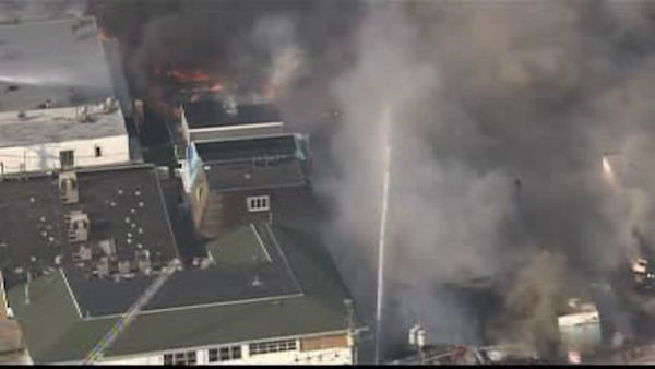 "<div class=""meta image-caption""><div class=""origin-logo origin-image ""><span></span></div><span class=""caption-text"">Fire crews are on the scene battling huge blaze at the Kohrs Custard shop on the boardwalk in Seaside Park, New Jersey.</span></div>"