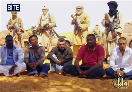 This image taken from video  and provided by U.S.-based SITE Intelligence Group Thursday Sept. 30, 2010 shows the first images of a group of foreign hostages working for a French energy company who were seized in Niger two weeks ago by an al-Qaida offshoot, according to the group that monitors terrorism. The hostages were grabbed in the middle of the night on Sept. 16 from their guarded villas in the uranium mining town of Arlit in Niger where they worked for French nuclear giant Areva. Five are French citizens, the other two are from Togo and Madagascar. &#40;AP Photo&#47;SITE&#41;  **  EDITORIAL USE ONLY  ** <span class=meta>(AP Photo&#47; Anonymous)</span>