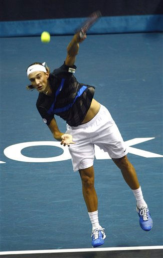 "<div class=""meta ""><span class=""caption-text "">Ruben Bemelmans of Belgium  serves the ball to Rafarl Nadal of Spain  during their second round match at the PTT Thailand Open tennis tournament in Bangkok, Thailand Thursday, Sept. 30, 2010. Nadal beat Ruben 6-1,6-4 (AP Photo/wason Wanichakorn) (AP Photo/ Wason Wanichakorn)</span></div>"