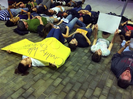 A group participates in a &#34;lie-in&#34; near the Student Center at Rutgers University, in New Brunswick, N.J Wednesday, Sept. 29, 2010. The rally was in support of safe places for gay students, in response to the death of a Rutgers University freshman who jumped off a bridge last week after a recording of him having a sexual encounter with a man was broadcast online.  &#40;AP Photo&#47;Erin Vanderbeg&#41; <span class=meta>(AP Photo&#47; Erin Vanderbeg)</span>