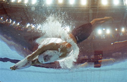 South Africa&#39;s Jean Basson competes in a Men&#39;s 200m Freestyle heat during the Commonwealth Games at the Dr. S.P. Mukherjee Swimming Stadium in New Delhi, India, Tuesday, Oct. 5, 2010. &#40;AP Photo&#47;Domenico Stinellis&#41; <span class=meta>(AP Photo&#47; Domenico Stinellis)</span>
