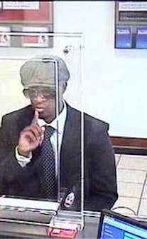 "On Wednesday, May 15, 2013 at approx. 10:10A.M., the suspect entered a Bank of America, located at 900 Third Avenue and passed a demand note. The suspect fled the location without any money. The suspect is described as a M/B/20-30, 5'8""-5'10"", 160-180lbs,wearing a black suit, white shirt with a tie, a brown hat&glasses. Please call Crime Stoppers at 1(800)577-TIPS."