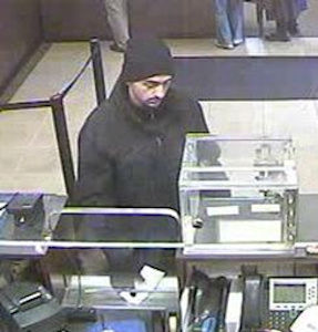 On Sunday, March 24, 2013 at approx.12:30P.M., inside the Chase Bank located at 71-41 Main Street in the confines of the 107 Precinct in Queens, the 2 suspects pictured above passed a note to the teller and demanded money. Please call Crime Stoppers at 1(800)577-T.I.P.S. All calls remain anonymous and confidential.