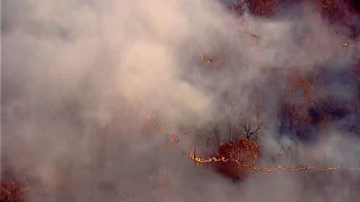 "<div class=""meta ""><span class=""caption-text "">Firefighters are battling a brush fire in Orangeburg, Rockland County, using air support to put out the flames.</span></div>"