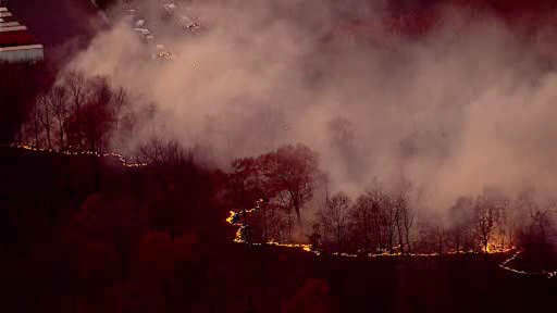 Firefighters are battling a brush fire in Orangeburg, Rockland County, using air support to put out the flames.