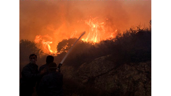 "<div class=""meta ""><span class=""caption-text "">Firefighters try to extinguish the flames in Tirat Hacarmel, northern Israel, Friday, Dec. 3, 2010. TCrews and equipment from around the world began arriving on Friday to help Israel's worst fire ever. The inferno, which also displaced thousands, is still raging through forests in northern Israel and on the outskirts of the country's third largest city, Haifa. (AP Photo/Sebastian Scheiner) (AP Photo/ Sebastian Scheiner)</span></div>"
