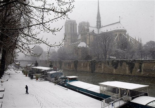 "<div class=""meta ""><span class=""caption-text "">Notre Dame cathedral is seen under the snow  in Paris, Wednesday Dec. 8, 2010, as a snow storm disrupted traffic in the French capital.(AP Photo/Remy de la Mauviniere) (AP Photo/ Remy de la Mauviniere)</span></div>"