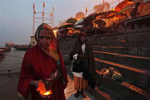 A Hindu devotee offers prayers at the Dashashvamedh ghat near the site of Tuesday&#39;s blast on the banks of the River Ganges in Varanasi, India, Wednesday, Dec. 8, 2010. Police were questioning two brothers for their alleged involvement in a blast that killed a toddler and triggered a stampede that left many others wounded in the holy Indian city, a top police official said Wednesday.&#40;AP Photo&#47;Rajesh Kumar Singh&#41; <span class=meta>(AP Photo&#47; Rajesh Kumar Singh)</span>