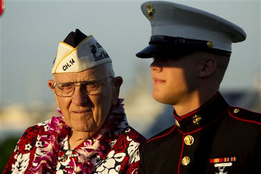 Pearl Harbor survivor John Hughes, left, and Lance Cpl. Zackary Morphew attend the 69th anniversary ceremony marking the attack on Pearl Harbor, Tuesday, Dec. 7, 2010, in Pearl Harbor, Hawaii.  &#40;AP Photo&#47;Marco Garcia&#41; <span class=meta>(AP Photo&#47; Marco Garcia)</span>