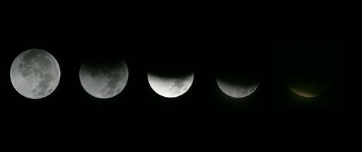 This photo combination shows the different stages of the moon during a lunar eclipse as seen from the Griffith Observatory in Los Angeles, Saturday, Dec. 10, 2011.  &#40;AP Photo&#47;Ringo H.W. Chiu&#41; <span class=meta>(AP Photo&#47; Ringo H.W. Chiu)</span>