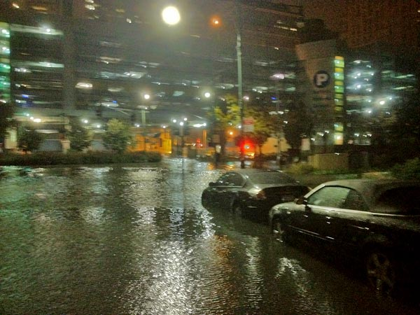 Heavy rainfall from superstorm Sandy floods a Lower Manhattan street Monday, Oct. 29, 2012. <span class=meta>(KABC reporter Rob McMillan)</span>