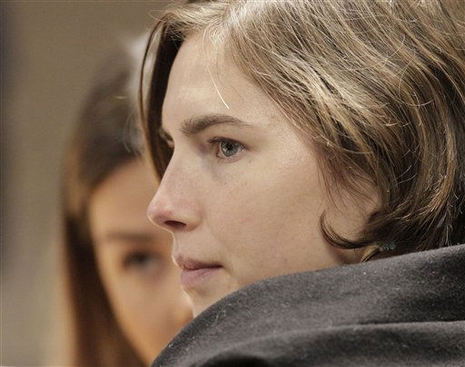 "<div class=""meta image-caption""><div class=""origin-logo origin-image ""><span></span></div><span class=""caption-text"">Amanda Knox, foreground, sits next to her lawyer Maria del Grosso during a hearing in her appeals trial, at Perugia's courthouse, Italy, Saturday, Dec. 11, 2010. The 23-year-old American student was convicted of murder and sexual assault in the 2007 death of her flatmate, British student Meredith Kercher, and sentenced to 26 years in prison. (AP Photo/Pier Paolo Cito) (AP Photo/ Pier Paolo Cito)</span></div>"