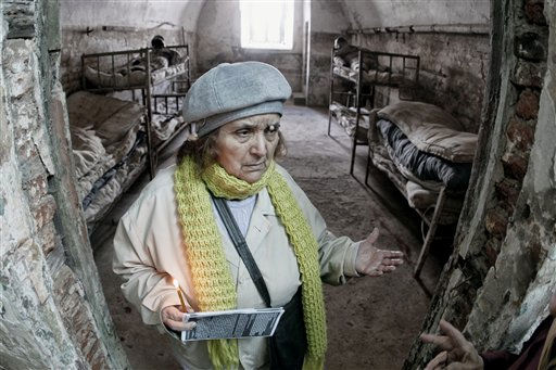 A woman, who declined to be identified, holds a candle as she walks in a prison cell in Fort 13 of the Jilava jail in Jilava, Romania, Friday, Dec. 10, 2010. Dozens of former political prisoners gathered on Human Rights Day to commemorate the anti communist fighters, parachuted by United States air force planes in the 1950s to organize a resistance movement, who were detained and executed in 1953 at the Jilava jail.&#40;AP Photo&#47;Vadim Ghirda&#41; <span class=meta>(AP Photo&#47; Vadim Ghirda)</span>