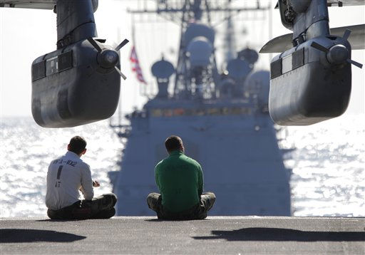 U.S. Navy Deck crew members take a rest on the USS George Washington aircraft carrier during &#34;Keen Sword&#34; U.S.-Japan joint military exercise over the Pacific Ocean, Friday, Dec. 10, 2010.&#40;AP Photo&#47;Itsuo Inouye&#41; <span class=meta>(AP Photo&#47; Itsuo Inouye)</span>