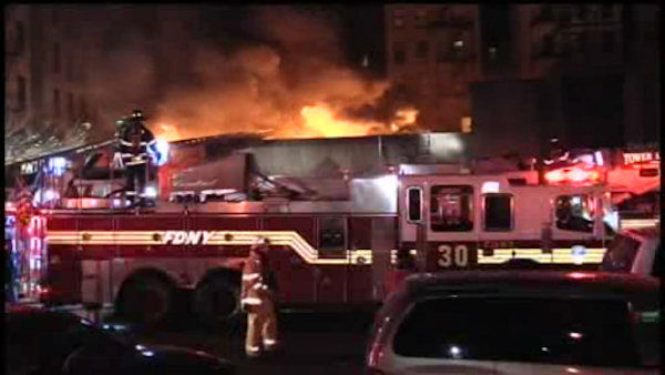 A raging 4-alarm fire burned through at least five buildings in Harlem on Friday night. <span class=meta>(WABC Photo&#47; Peter Gerber)</span>