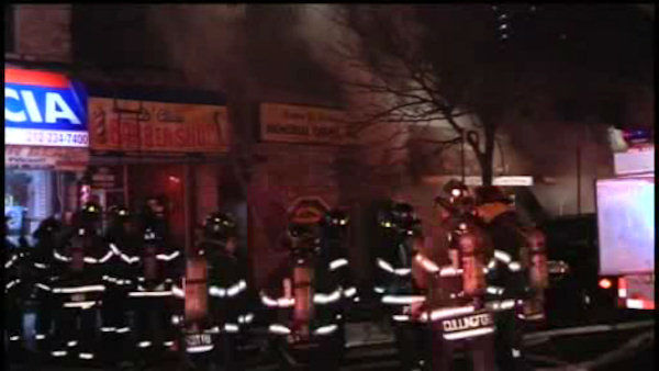 "<div class=""meta image-caption""><div class=""origin-logo origin-image ""><span></span></div><span class=""caption-text"">A raging 4-alarm fire burned through at least five buildings in Harlem on Friday night. (WABC Photo/ Peter Gerber)</span></div>"