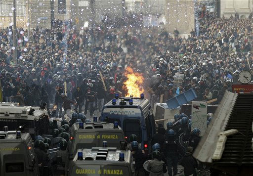 "<div class=""meta ""><span class=""caption-text "">Demonstrators, background, clash with police in Rome's Piazza del Popolo Square, Tuesday, Dec. 14, 2010. Premier Silvio Berlusconi won back-to-back votes of confidence in the Italian parliament Tuesday to survive one of the toughest tests of his political life. But he was left with a razor-thin majority that will make it hard for him to govern effectively. As lawmakers cast their votes, a violent core of anti-Berlusconi protesters outside clashed with police, smashing shop windows, setting cars on fire and hurling firecrackers, eggs and paint. (AP Photo/Alessandra Tarantino) (AP Photo/ Alessandra Tarantino)</span></div>"
