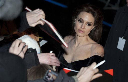 U.S. actress Angelina Jolie signs autographs as she arrives for the Europe Premiere of the movie &#34;The Tourist&#34; in Berlin, Germany, Tuesday, Dec. 14, 2010. &#40;AP Photo&#47;Gero Breloer&#41; <span class=meta>(AP Photo&#47; Gero Breloer)</span>