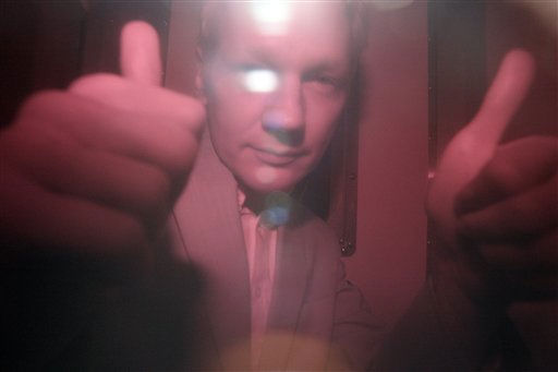 "<div class=""meta image-caption""><div class=""origin-logo origin-image ""><span></span></div><span class=""caption-text"">WikiLeaks founder Julian Assange reacts behind the heavily tinted window of a police van as he arrives at Wandsworth Prison in London, Tuesday Dec. 14, 2010. A British judge granted Assange bail on Tuesday but he will remain in custody for at least another 48 hours after Swedish prosecutors said they would challenge the decision.(AP Photo/Akira Suemori) (AP Photo/ Akira Suemori)</span></div>"