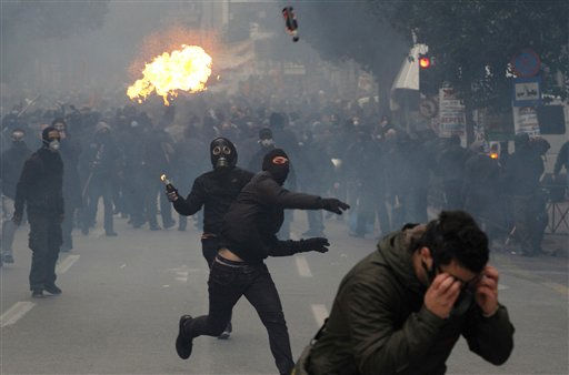 "<div class=""meta ""><span class=""caption-text "">Protesters throw petrol bombs during clashes in Athens, Wednesday, Dec. 15, 2010. Hundreds of protesters clashed with riot police across central Athens Wednesday, smashing cars and hurling gasoline bombs during a massive labor protest against the government's austerity measures. Wednesday's violence occurred after some 20,000 protesters marched to parliament during a general strike against a new round of labor reforms in the crisis-hit country. (AP Photo/Alkis Konstantinidis) (AP Photo/ Alkis Konstantinidis)</span></div>"