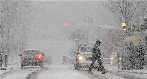 "<div class=""meta ""><span class=""caption-text "">A pedestrian crosses a road during a snow-fall in central London, Saturday, Dec. 18, 2010. Plunging temperatures and heavy snow saw large swathes of Britain grind to a standstill, as London's Gatwick Airport closed its runway and British Airways cancelled flights at Heathrow. (AP Photo/Alastair Grant) (AP Photo/ Alastair Grant)</span></div>"