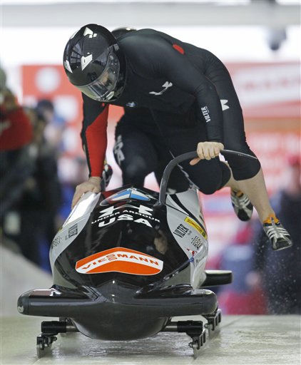 U.S. driver Steven Holcomb and brakeman Steven Langton, not shown, start their first heat in the two-man bobsled World Cup in Lake Placid, N.Y., Saturday, Dec. 18, 2010. &#40;AP Photo&#47;Mike Groll&#41; <span class=meta>(AP Photo&#47; Mike Groll)</span>