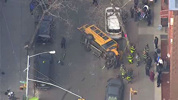 A small school bus carrying students overturned Monday afternoon in Bedford-Stuyvesant.