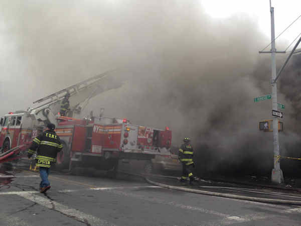 "<div class=""meta ""><span class=""caption-text "">Firefighters battled a fire Sunday at a building housing a row of stores in the Mount Hope section of the Bronx.</span></div>"