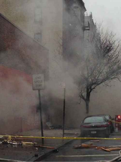 "<div class=""meta ""><span class=""caption-text "">Firefighters battled a fire Sunday at a building housing a row of stores in the Mount Hope section of the Bronx.  (Via Twitter)</span></div>"