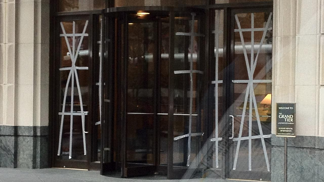 Duct tape is seen on the doors and windows of the Grand Tier Luxury apartments in New York City as Hurricane Sandy approaches on Monday, Oct. 29, 2012. <span class=meta>(KABC Reporter Rob McMillan)</span>