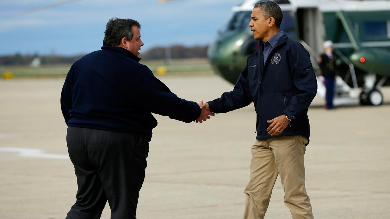 President Barack Obama is greeted by New Jersey Gov. Chris Christie upon his arrival at Atlantic City International Airport, Wednesday, Oct. 31, 2012, in Atlantic City.