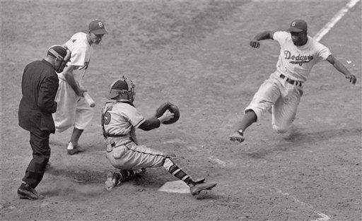 ** FILE ** Brooklyn Dodgers&#39; Jackie Robinson steals home plate successfully as Boston Braves&#39; catcher Bill Salkeld is thrown off-balance on pitcher Bill Voiselle&#39;s throw to the plate during the fifth inning of a Boston-Brooklyn game at Ebbets Field in New York, in this Aug.  22, 1948 file photo. Third baseman Billy Cox, who was at bat, watches Jackie slide. The umpire is Jocko Conlan. The  Braves won 4-3. &#40;AP Photo&#47;Jack Harris&#41; <span class=meta>(AP Photo&#47; JACK HARRIS)</span>