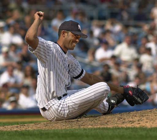 New York Yankees closer Mariano Rivera holds up the ball after spearing a line drive off the bat of Texas Rangers&#39; Chad Curtis for the first out of the ninth inning in the Yankees&#39; 8-7 victory over the Rangers, Thursday, Aug. 24, 2000, at New York&#39;s Yankee stadium.  &#40;AP Photo&#47;Kathy Willens&#41; <span class=meta>(AP Photo&#47; KATHY WILLENS)</span>