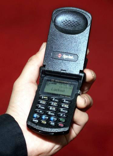 "<div class=""meta ""><span class=""caption-text "">ADVANCE FOR MONDAY, OCT. 30--The Sprint StarTac is seen at the at the Internet World conference in New York Wednesday, Oct. 25, 2000. Cell phones, handheld devices and car navigation systems will soon have tracking abilities, if they don't already, providing added value to consumers but raising concerns about privacy. (AP Photo/Ed Bailey) (AP Photo/ ED BAILEY)</span></div>"