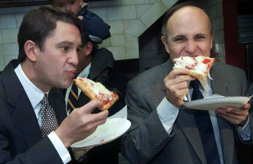 Senate candidate Rep. Rick Lazio, R-N.Y., left, and New York Mayor Rudolph Giuliani eat a piece of pizza at DaVinci Pizzeria, in the Bensonhurst neighborhood of Brooklyn, Monday Nov. 6, 2000 in New York. <span class=meta>(AP Photo&#47;Suzanne Plunkett)</span>