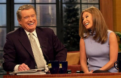 **FILE**Host Regis Philbin shares a laugh with co-host Kelly Ripa during a broadcast of &#34;Live with Regis and Kelly&#34; on Feb. 5, 2001, in New York.  Philbin, in a telephone call to the show Monday, April 16, 2007, said he plans to return to his syndicated talk show April 26, about six weeks after having triple bypass heart surgery.&#40;AP Photo&#47;Kathy Willens&#41; <span class=meta>(AP Photo&#47; KATHY WILLENS)</span>