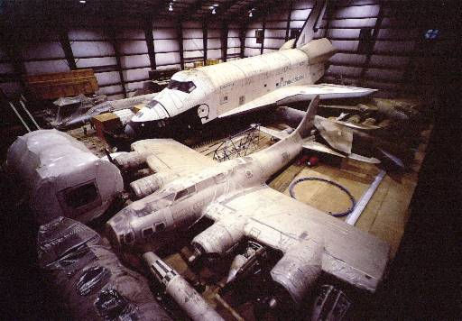A Washington news conference held Tuesday, April 10, 2001, supplied this photograph of aircraft in storage at the Smithsonian&#39;s private hanger located at Washington Dulles International Airport. These aircraft, which include the Space Shuttle Enterprise, in background, will be displayed at the new Steven F. Udvar-Hazy Center, located near Washington Dulles International Airport. The center will contain three levels and is scheduled to open December of 2003. &#40;Ap Photo&#47;Courtesy Smithsonian National Air and Space Museum&#41; <span class=meta>(AP Photo&#47; Anonymous)</span>