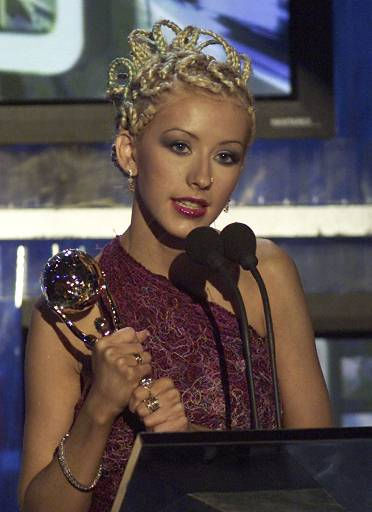 """<div class=""""meta image-caption""""><div class=""""origin-logo origin-image """"><span></span></div><span class=""""caption-text"""">Singer Christina Aguilera holds the award of the World's best selling latin female artist, during the 2001 World Music Awards ceremony in Monaco, Wednesday, May 2, 2001. (AP Photo/Lionel Cironneau) (AP Photo/ LIONEL CIRONNEAU)</span></div>"""